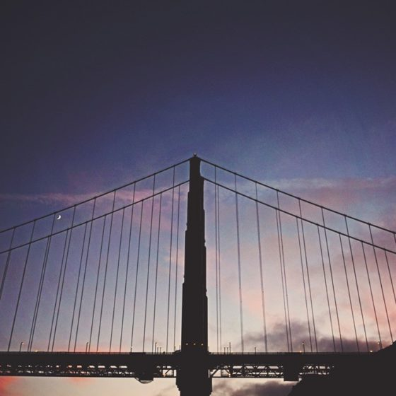 sunset behind the golden gate bridge on cruise through Vibmly