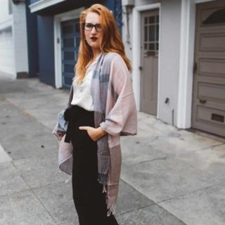 pink scarf black wide leg pants woman red hair