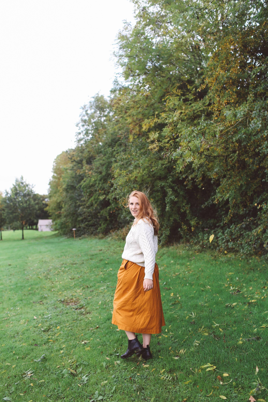 Lyrath Estate orange skirt white sweater