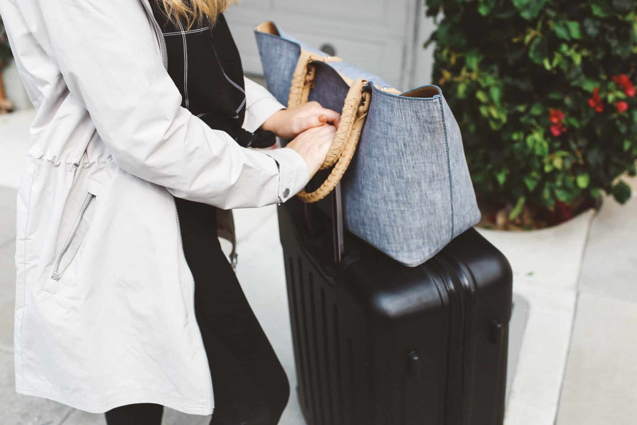 packing suitcase grey coat street leggings