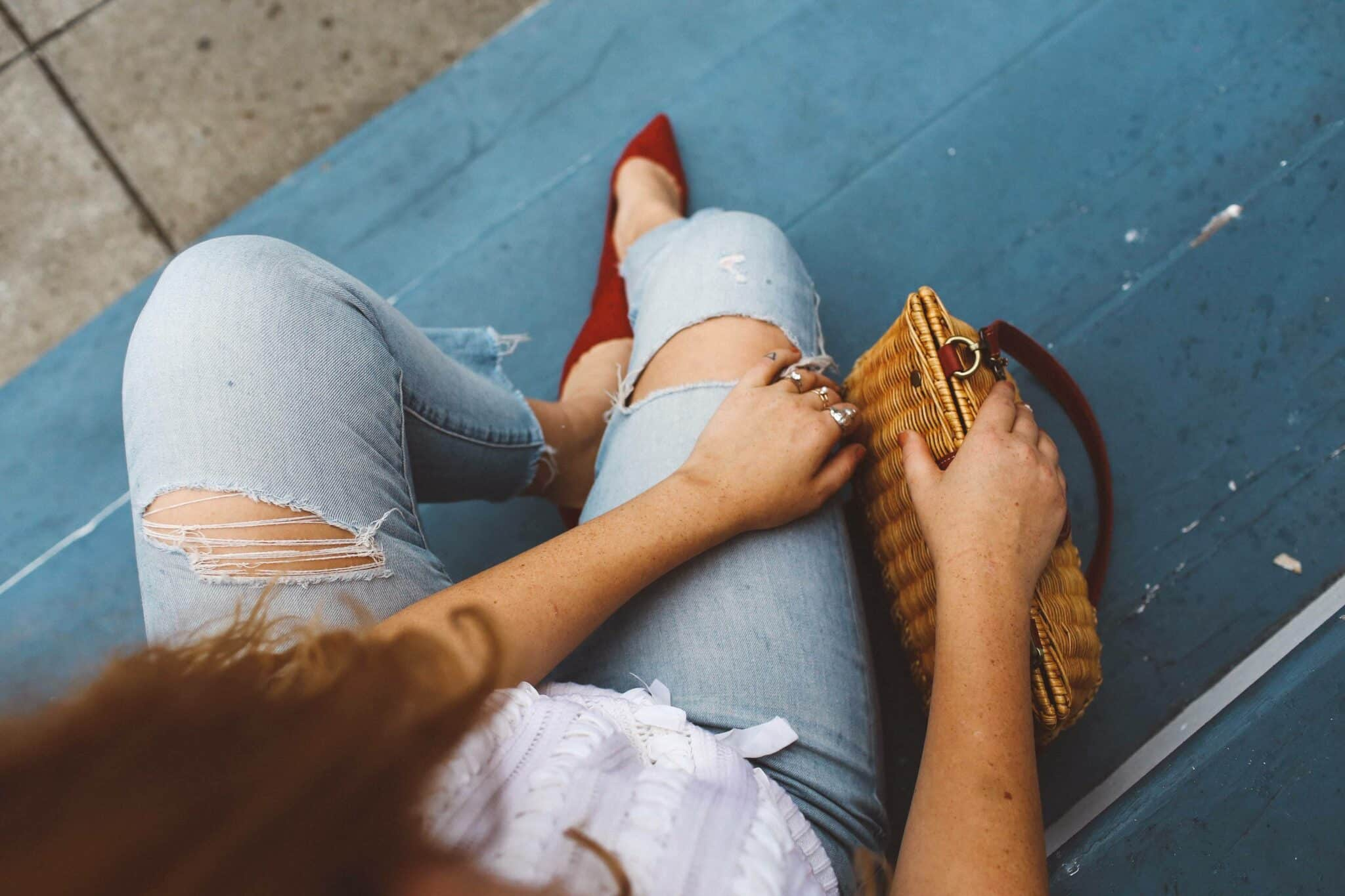 red heels wicker purse jeans