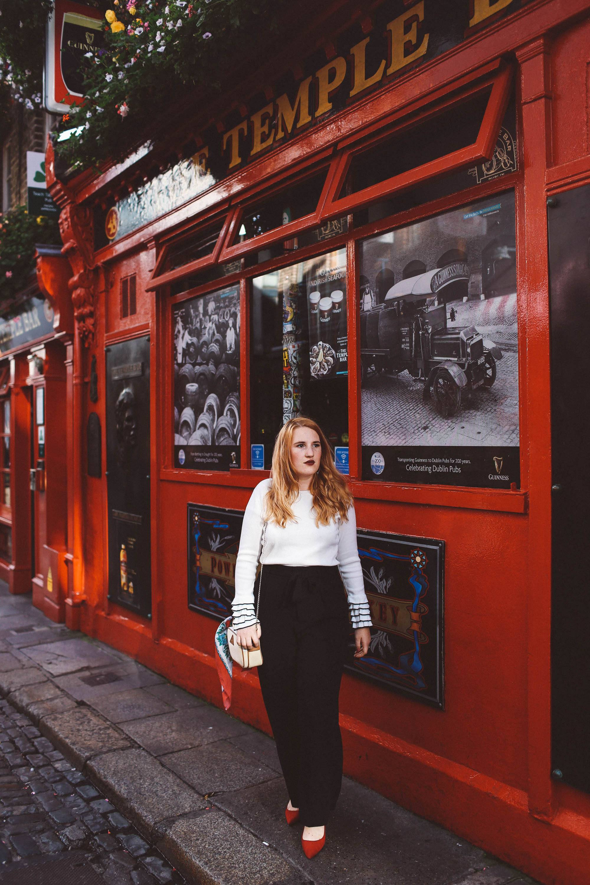 temple bar woman white sweater black pants