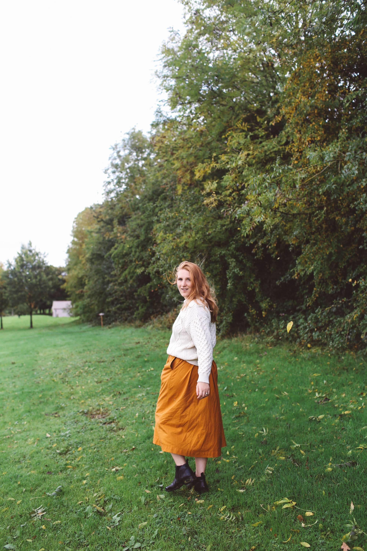 woman white sweater orange midi skirt ireland