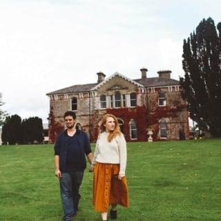 couple holding hands ireland orange skirt