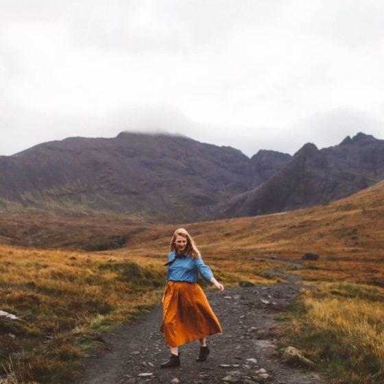 fairy pools isle of skye orange skirt woman