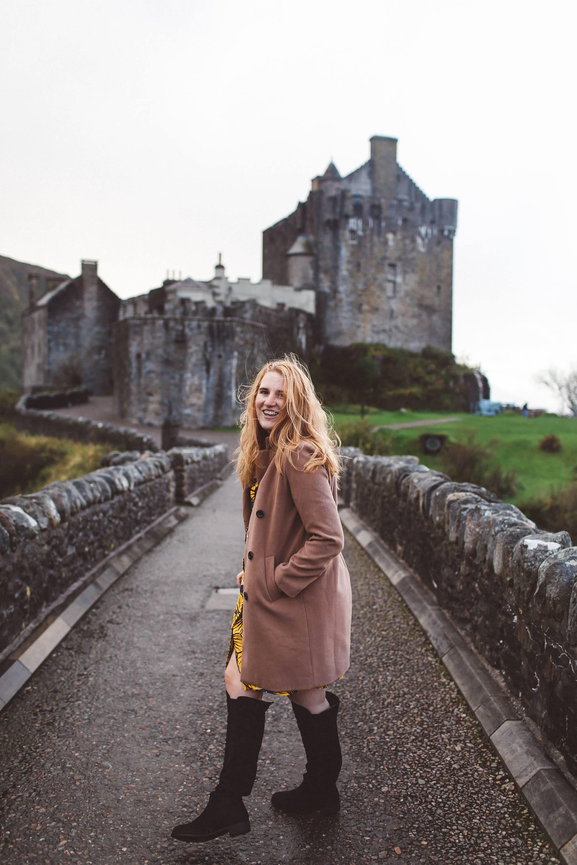 elieen donan castle scotland camel coat