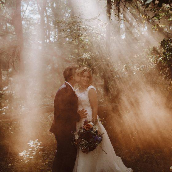 wedding smoke bombs woods bride groom