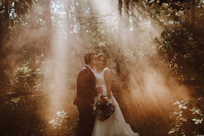 wedding smoke bombs woods bride groom