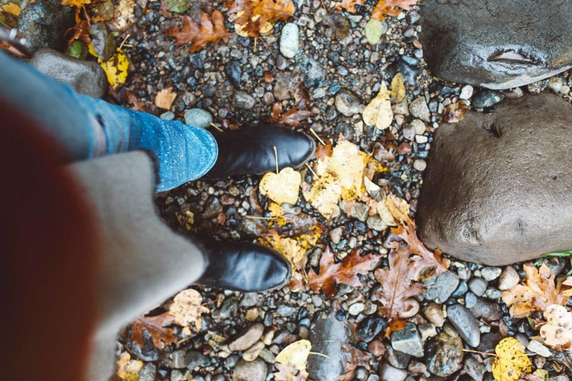 black boots fall leaves