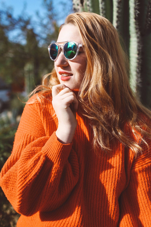 red sweater sunglasses