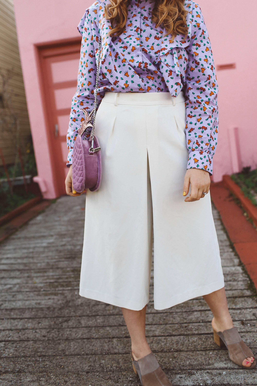 pineapple purse, purple ruffle shirt, pink house