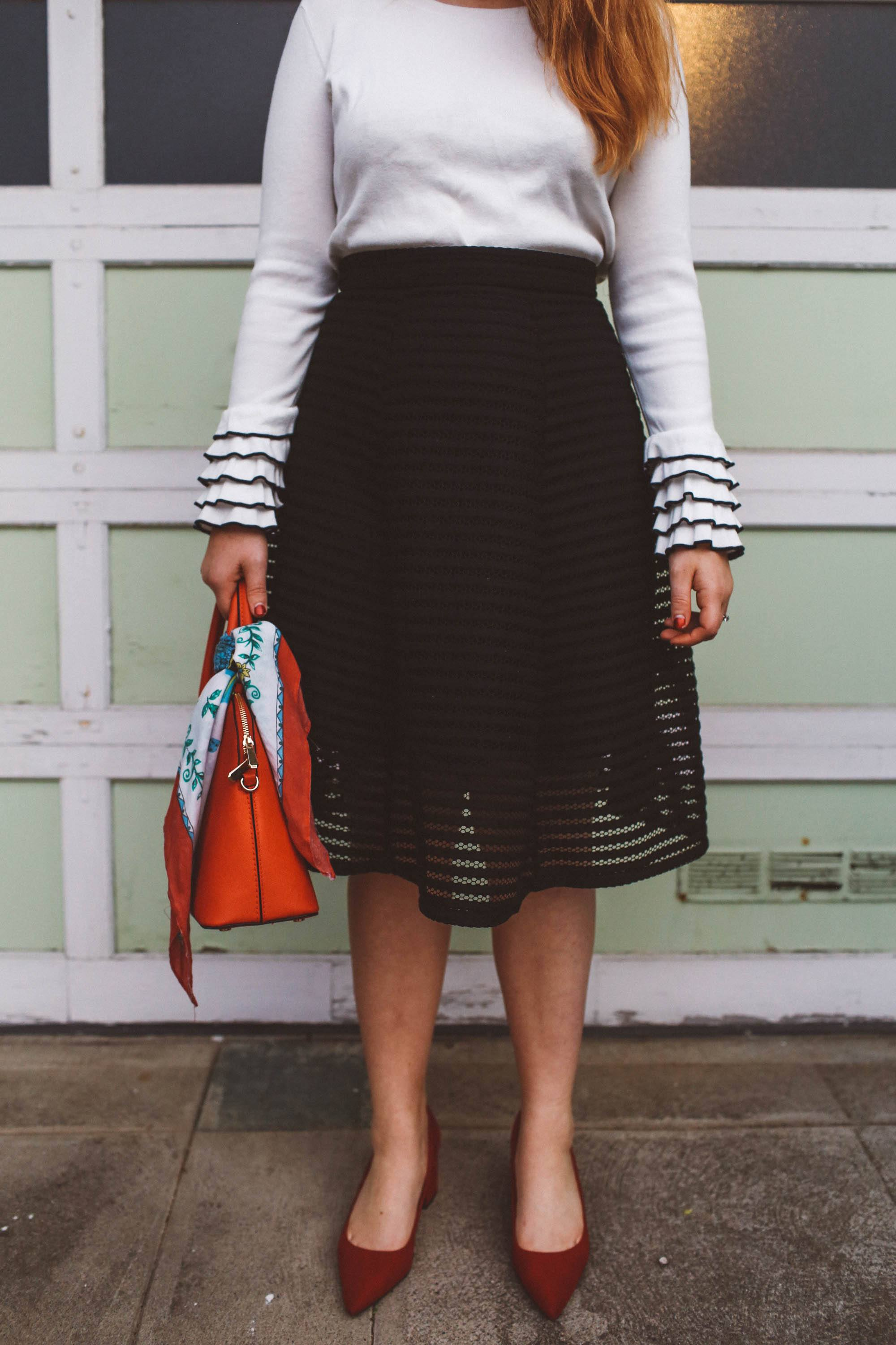 head scarf red purse black skirt ruffle sweater