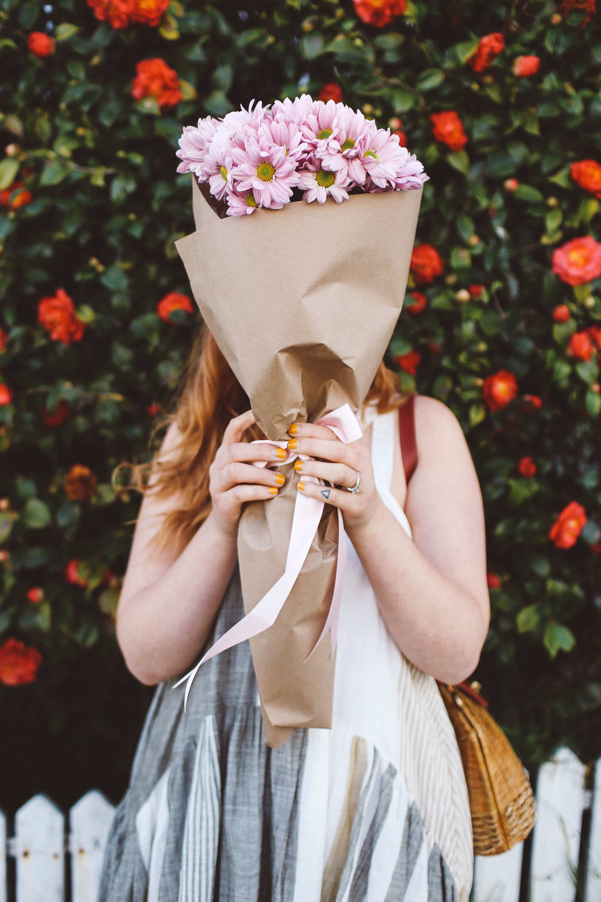 woman holding flowers face