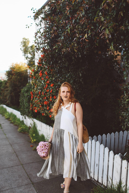 woman red hair flower wall boho dress