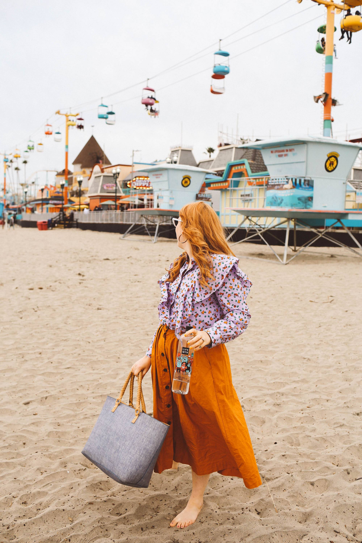santa cruz boardwalk woman orange skirt beach