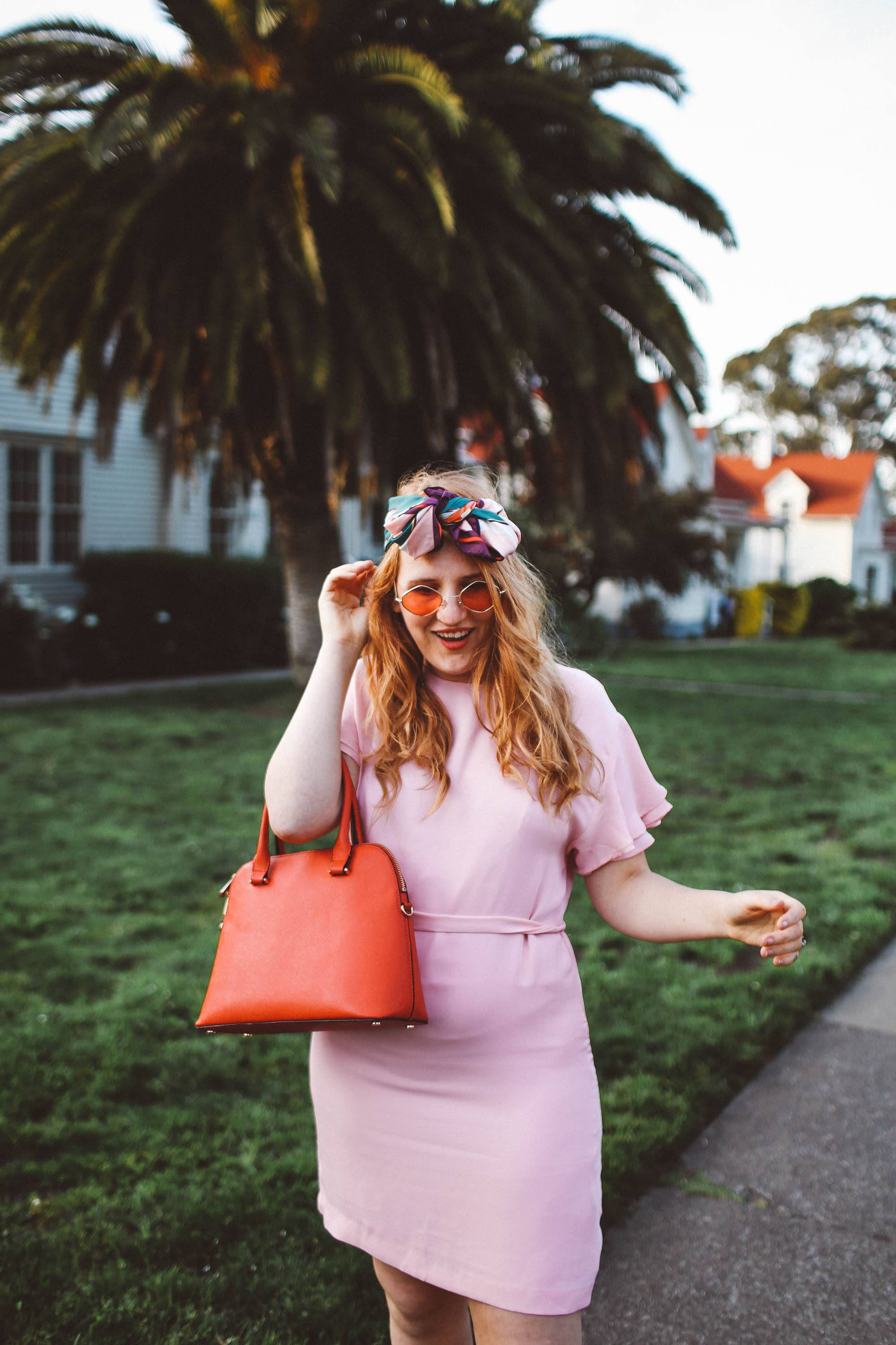 woman wearing headscarf, pink dress, pink sunglasses in San Francisco Presidio