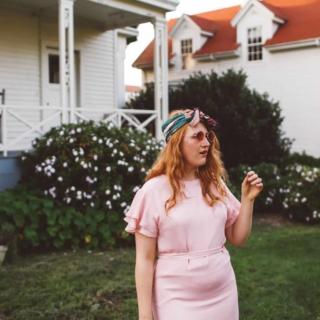 woman wearing headscarf, pink dress, pink sunglasses in San Francisco Presidio