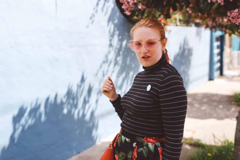 Woman in black top wearing a cool pin in San Francisco