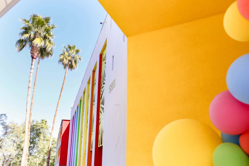 Palm trees and colorful wall in palm springs