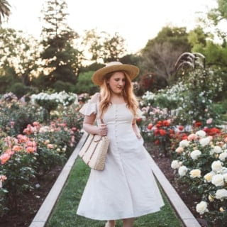 Gal Meets Glam collection dress line in rose garden