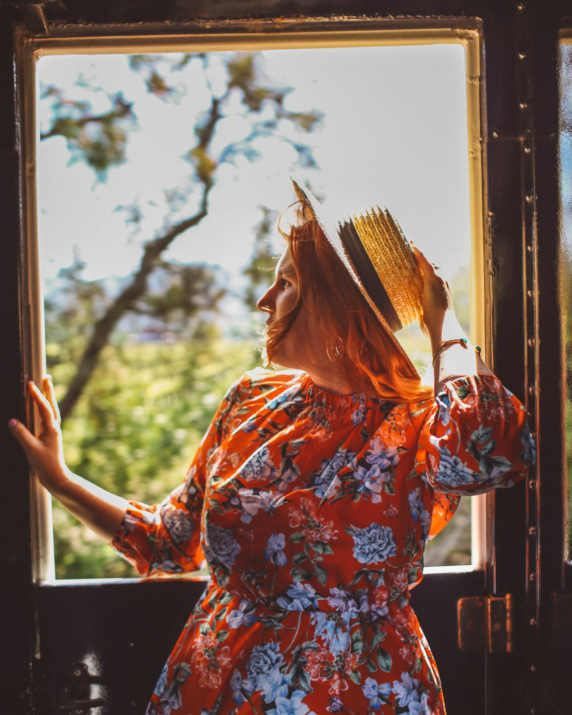 Woman in floral dress and straw on the Napa Valley Wine Train
