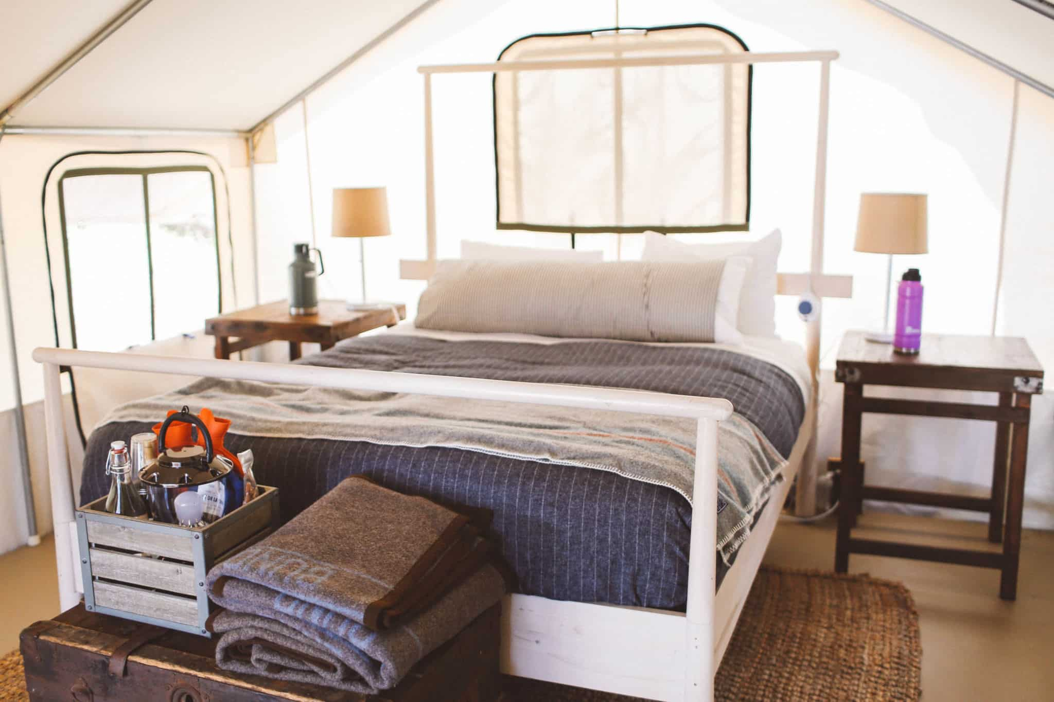 Bed and side tables in tent