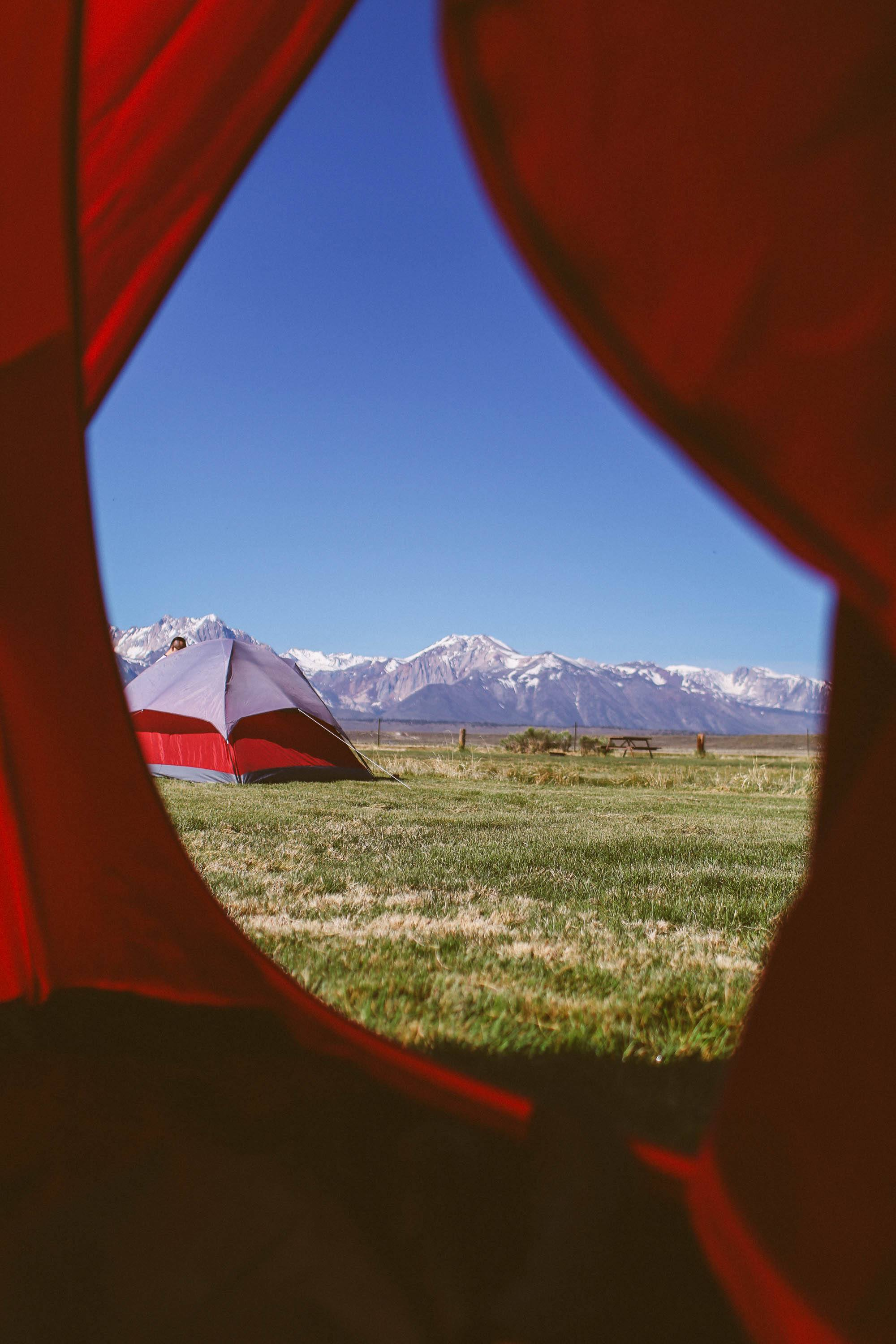 photo of a tent and the mountains from inside of a tent