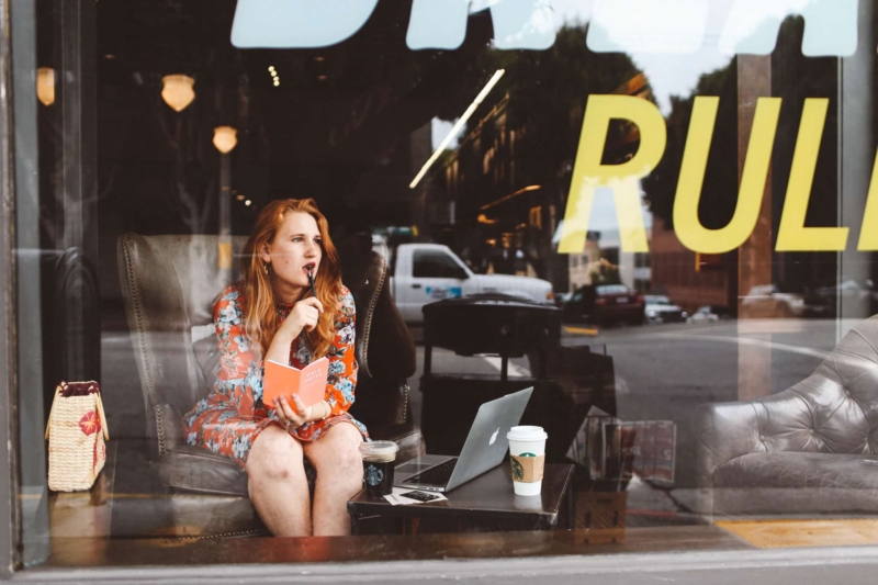 Woman in comfy chair working in starbucks