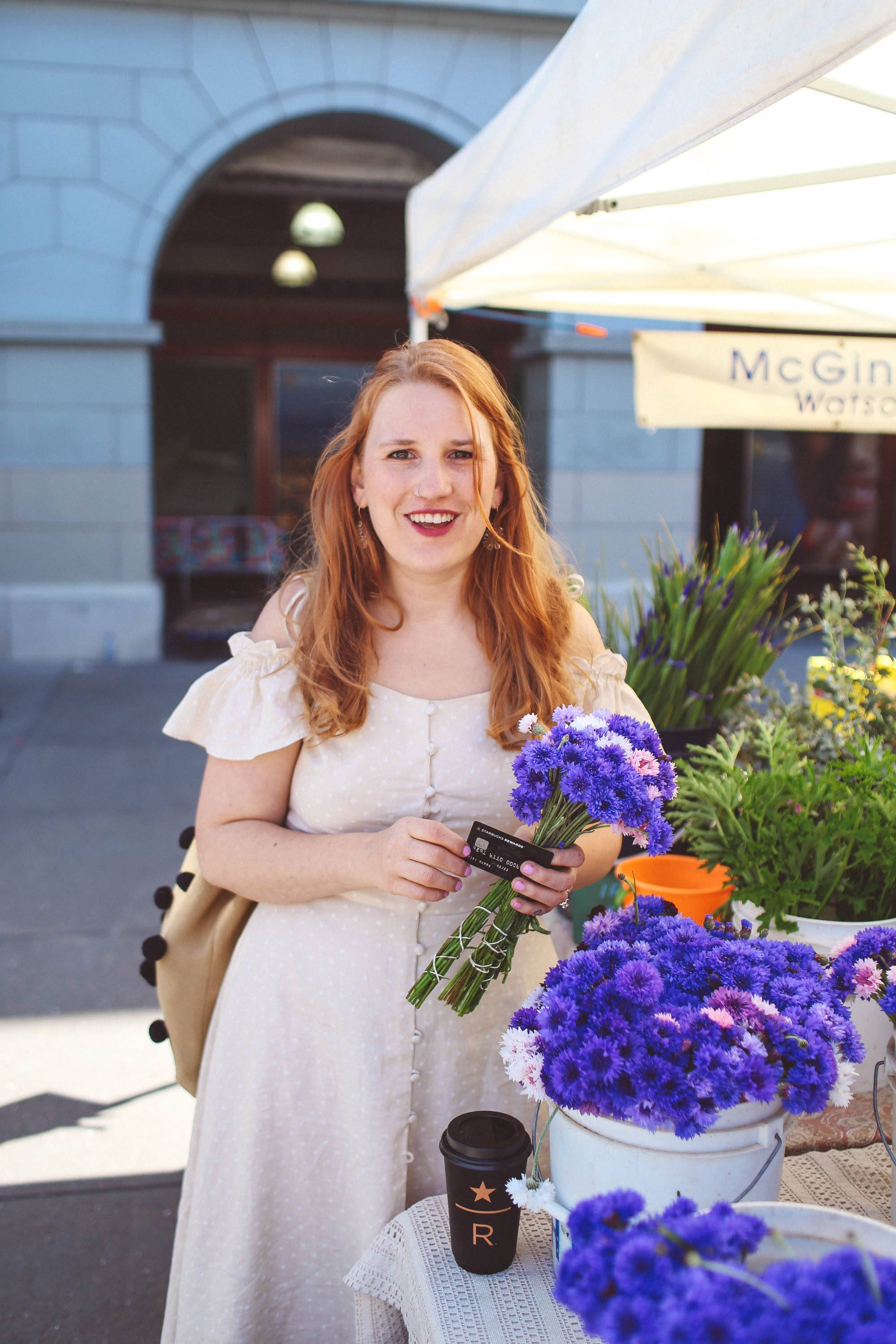 woman in vintage dress holding blue flwers