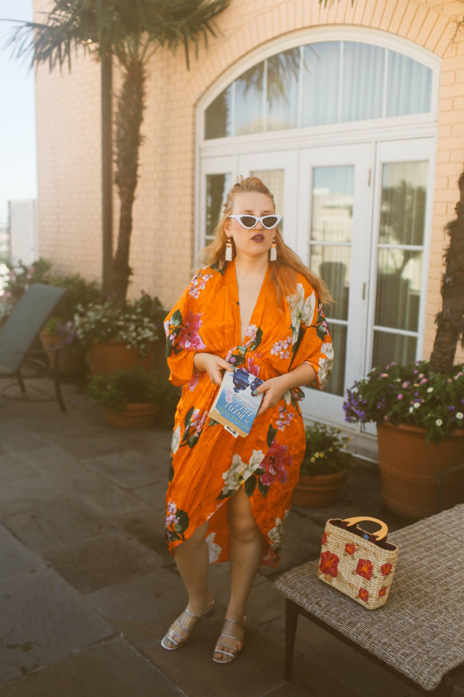 Woman in orange floral Kimono at the pool area at Hotel Monteleone