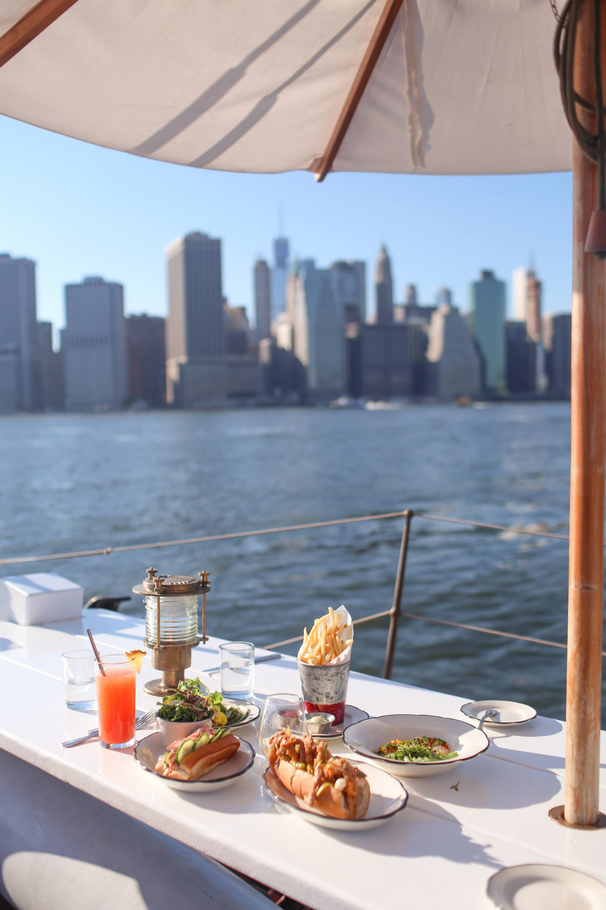 Food at Pilot, Manhattan in the background.