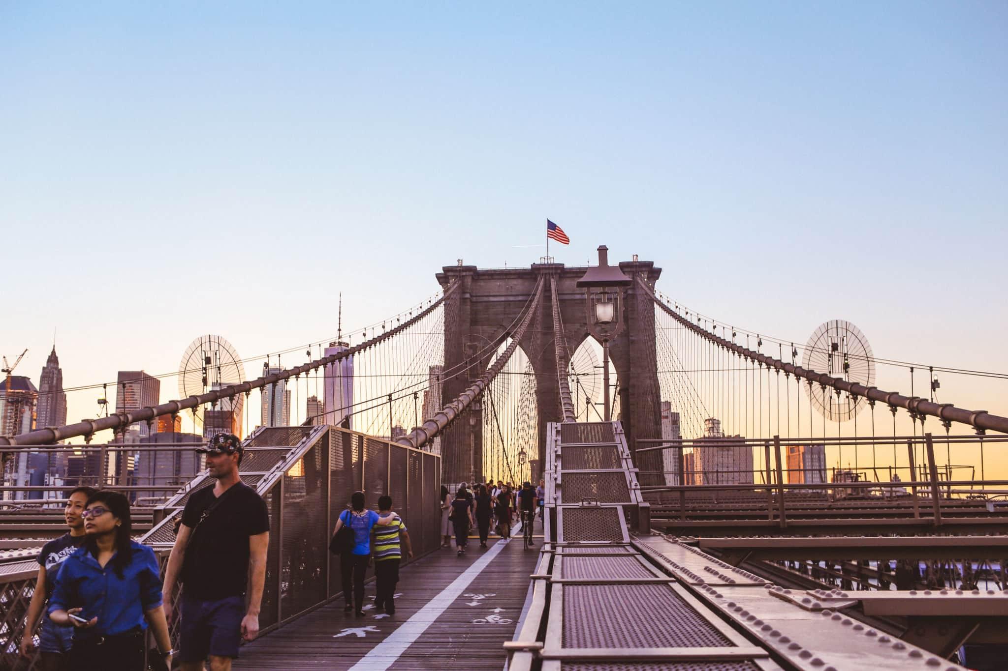 People on the Brooklyn Bridge at dusk
