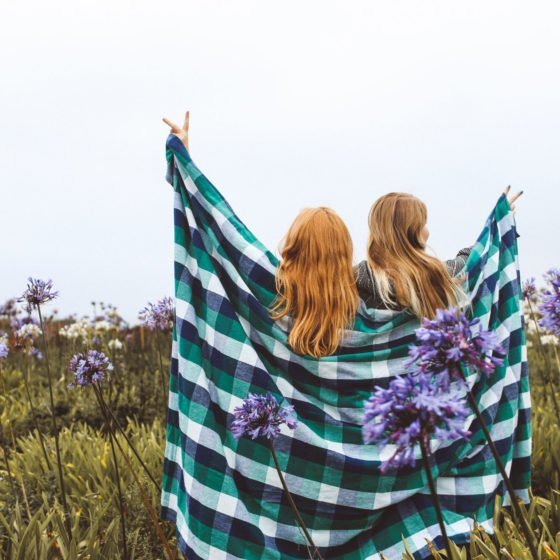 Two Women standing with blanket around them