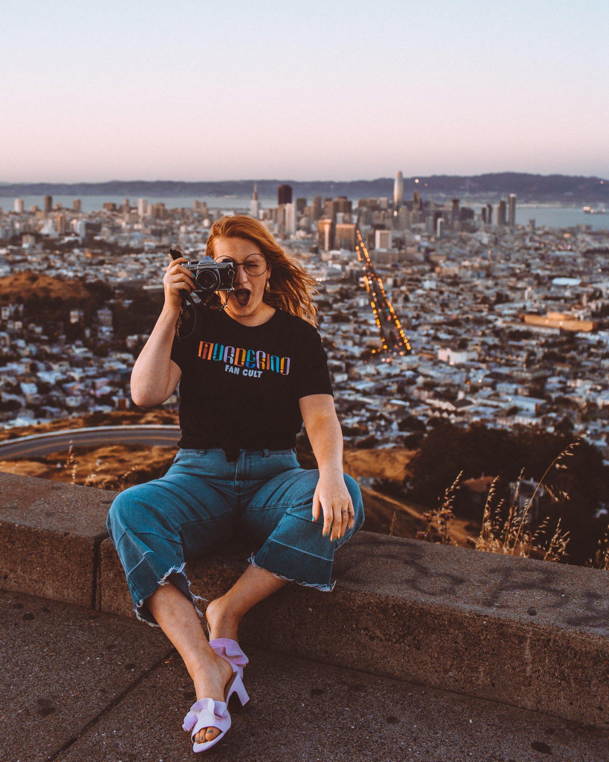Woman On a peak overlooking San Francisco