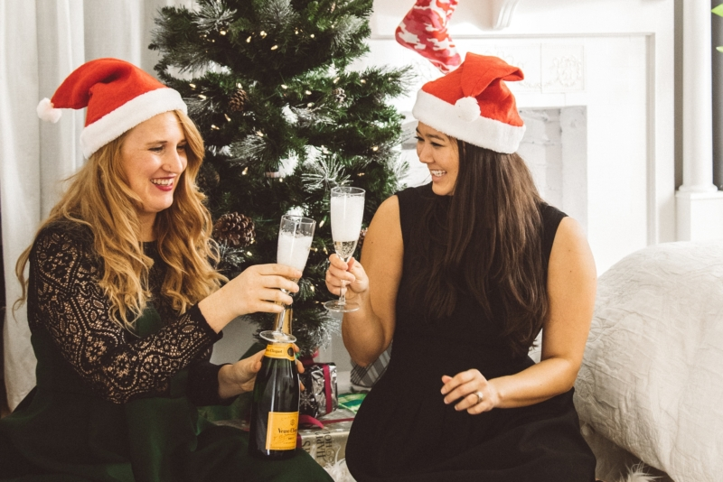 women drinking champagne by tree