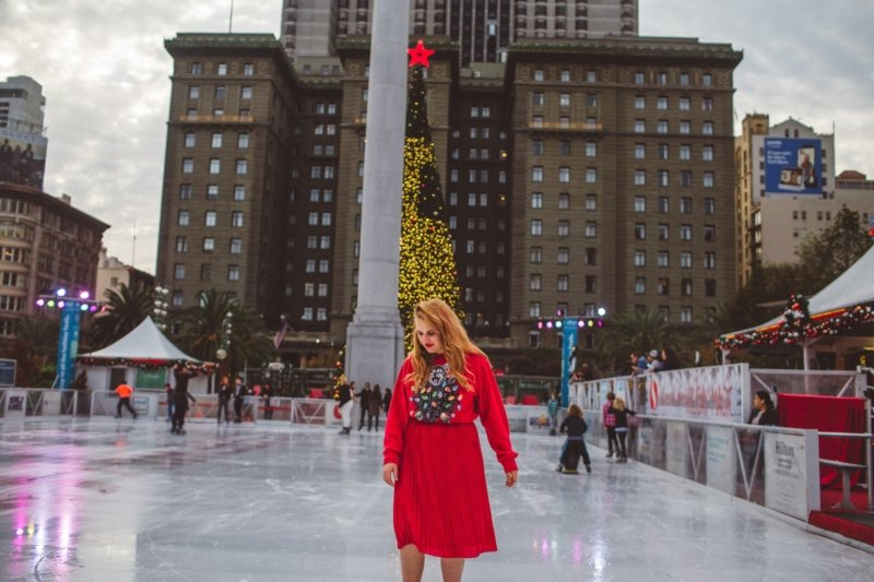union square ice skate ugly Christmas sweater girl skating