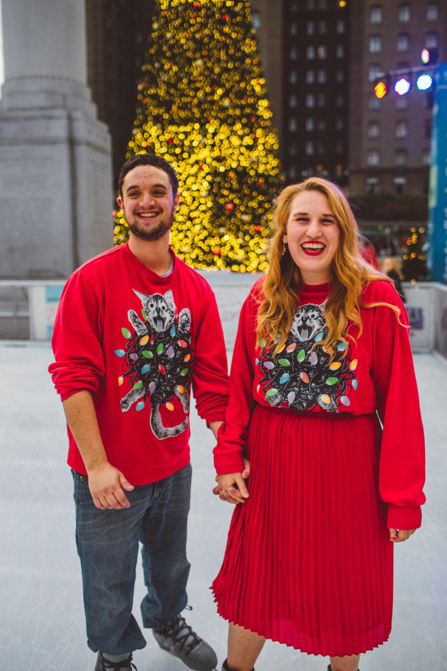 union square ice skate ugly Christmas sweater couple skating