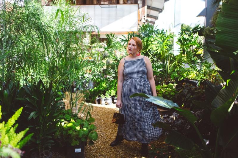 Woman wearing Gingham Dress at Flora Grubb