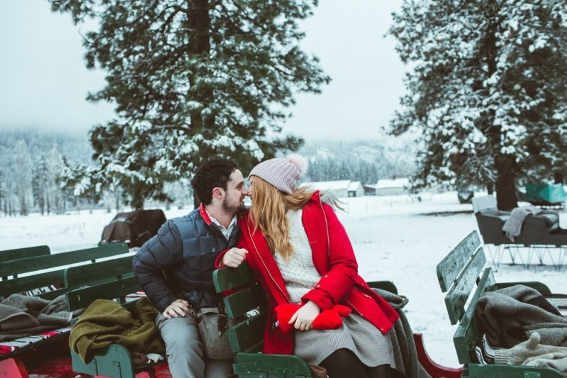 man and woman on a sleigh
