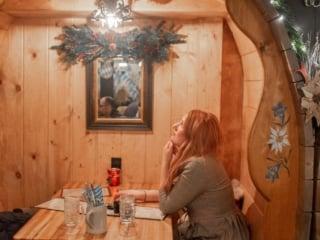 Woman sitting at barrel table at andreas keller