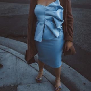 Woman wearing baby blue fan dress