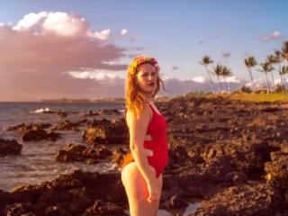 wearing my red swimsuit on Kiwakapu beach in maui