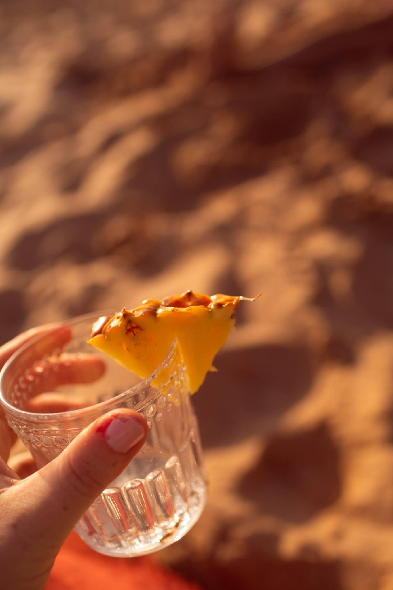 glass with pineapple garnish