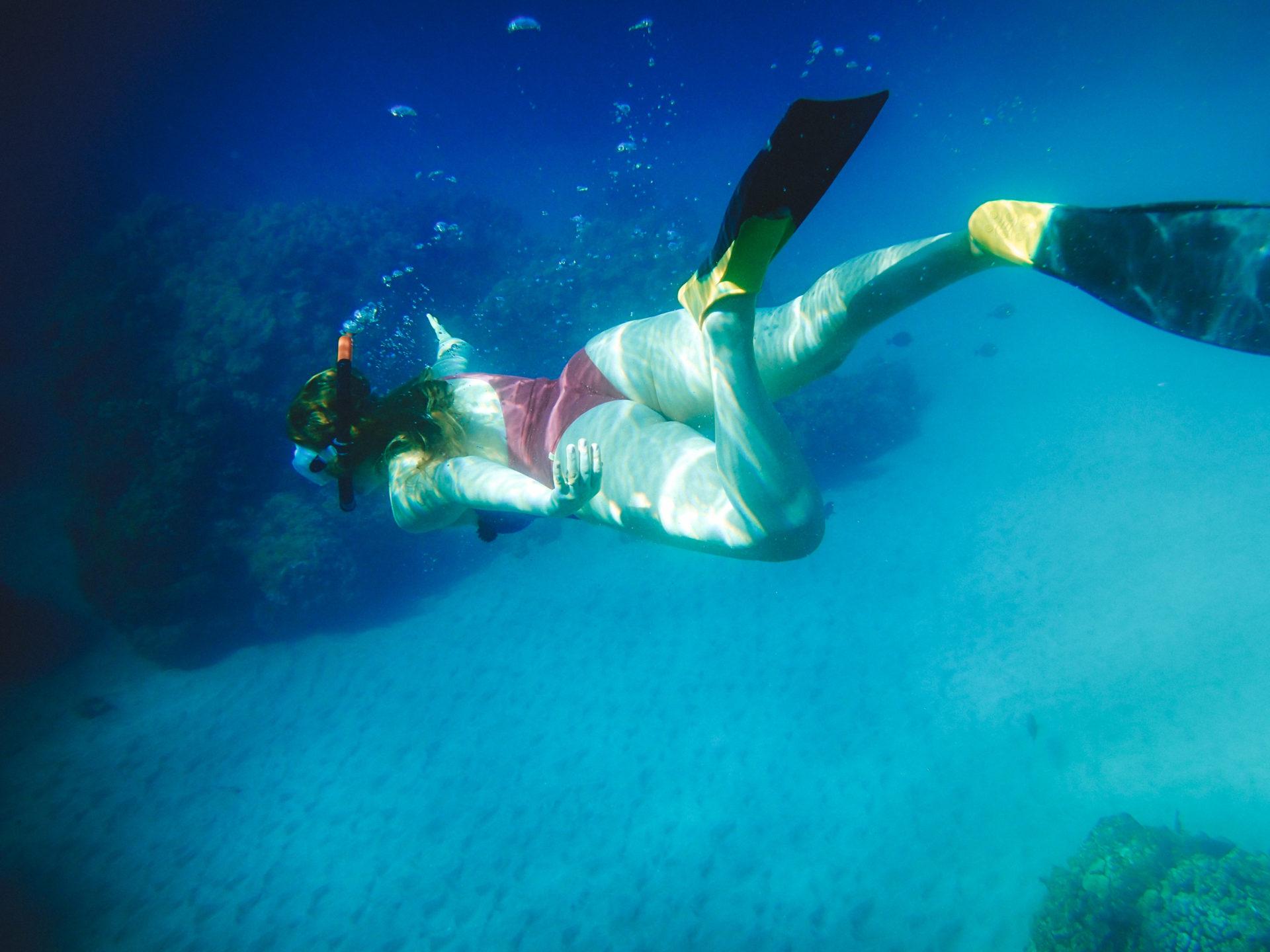 Snorkel Maui Hawaii Cruise - woman snorkeling in coral reef