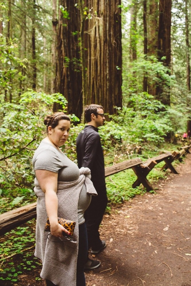 A couple taking a walk in Armstrong Woods State Park