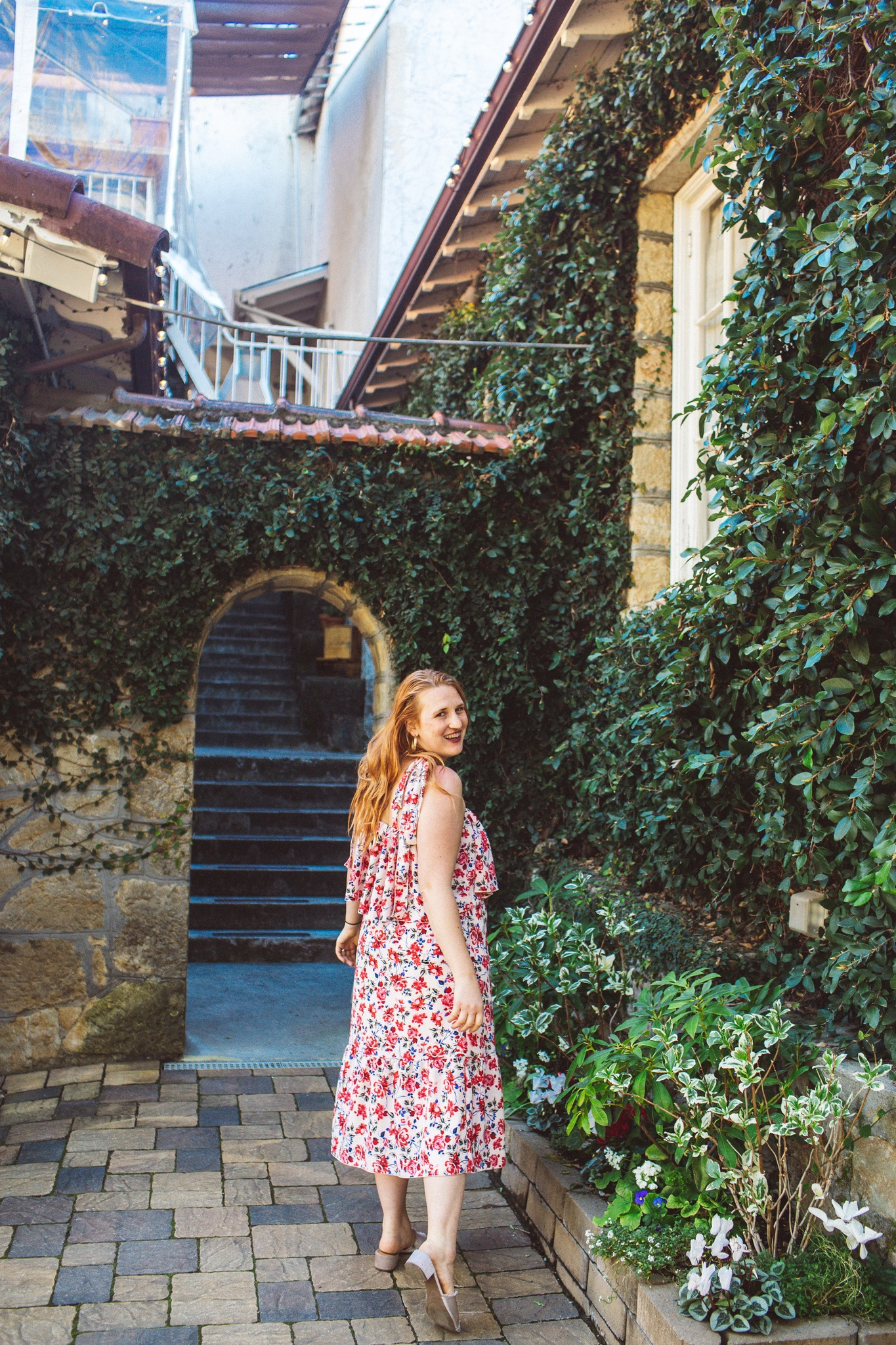 Woman in floral dress at Testarossa Winery in the Santa Cruz mountains