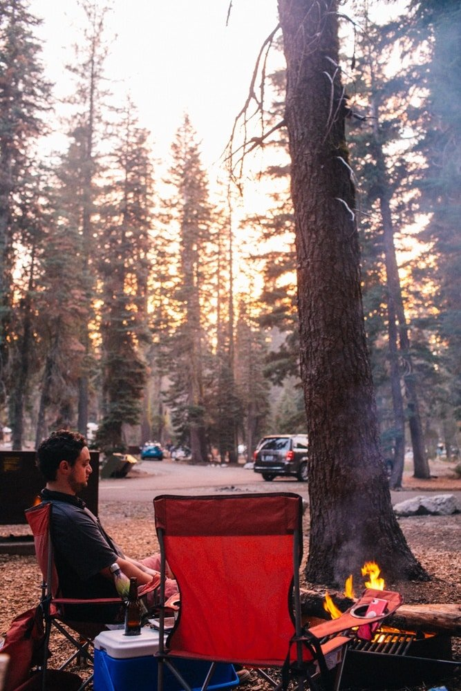 Robin sitting around the campfire in Lassen National Park