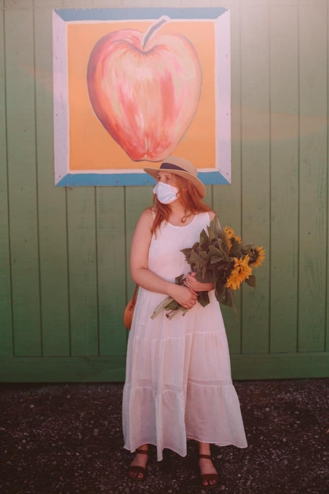 Kara and her Sunflowers at Andreotti Sunflower Farm in Half Moon Bay, California