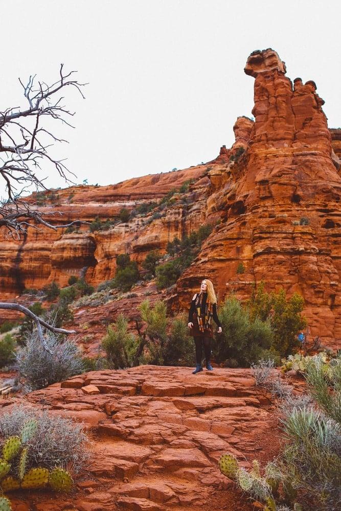 Kara of Whimsy Soul standing on Sedona Arizona Red Rocks