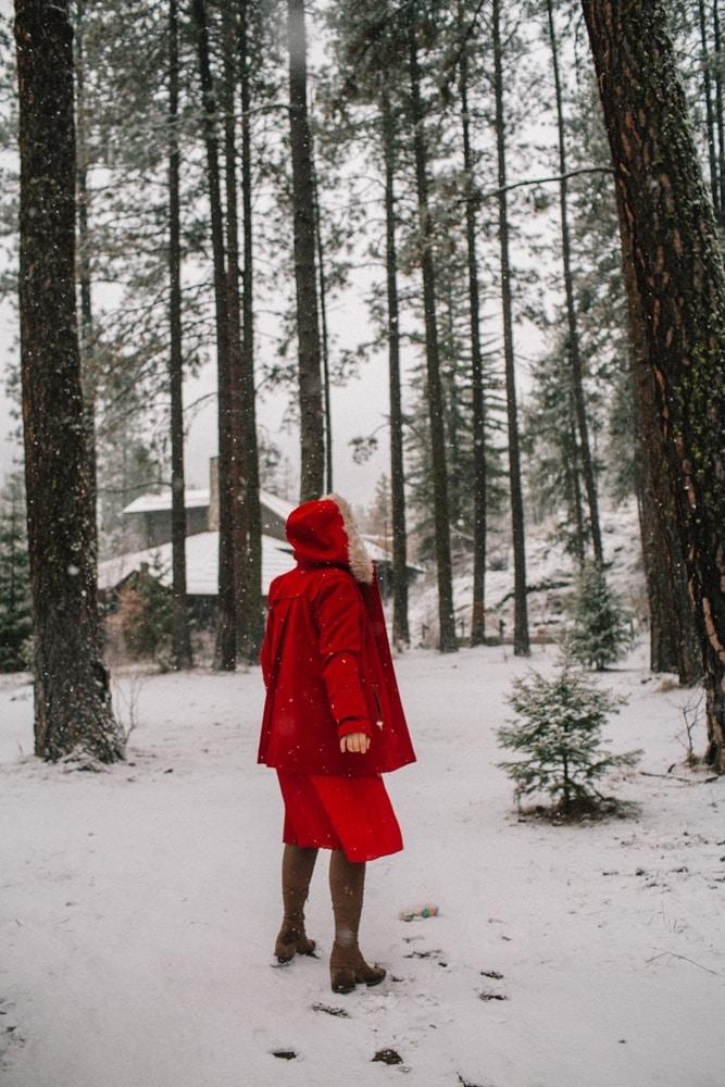 Kara in her red winter coat at the Sleeping Lady Mountain in Leavenworth, Washington